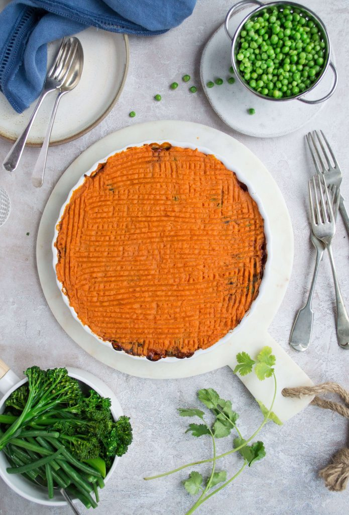 Cottage pie with sweet potato mash in a round white dish